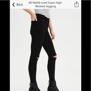 Black jeans with rips in knees